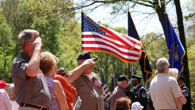 Veterans salute the American Flag