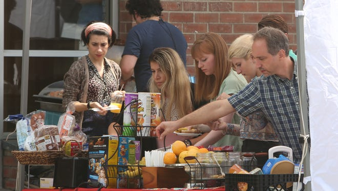 Cast and crew from Orange Is The New Black take a lunch break during filming of scenes at Homefield Bowl on Saw Mill River Road in Yonkers Aug. 9, 2016.