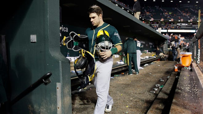 Oakland Athletics catcher Josh Phegley walks out of the dugout after the second baseball game of a doubleheader against the Baltimore Orioles in Baltimore, Saturday, May 7, 2016. Baltimore won 5-2.