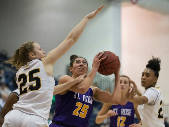 SJV's Katie Hill tries to block a shot by St. Rose's