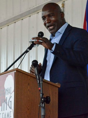 Evander Holyfield gives his speech at the International Boxing Hall of Fame's induction ceremony in Canastota, N.Y.