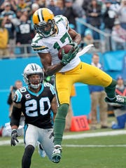 Green Bay Packers wide receiver Davante Adams (17) makes a leaping catch for a touchdown in the first quarter against the Carolina Panthers on Sunday, Dec. 17, 2017 at Bank of America Stadium in Charlotte, N.C.