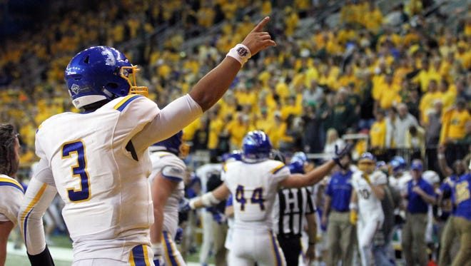 South Dakota State quarterback Taryn Christion points to the SDSU fans after throwing the game-winning touchdown late in the fourth quarter of the Jackrabbits' 19-17 on Saturday at the Fargodome in Fargo, N.D.