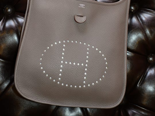"This Hermes Evelyn Cross-body purse with ""H"" logo and"