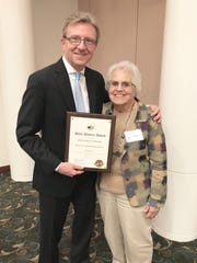 Kendall Wingrove, a member of the Historical Society of Michigan (left) presents the State History Award to Wanda Edie who accepted it on behalf of the Algonac-Clay Township Historical Society.