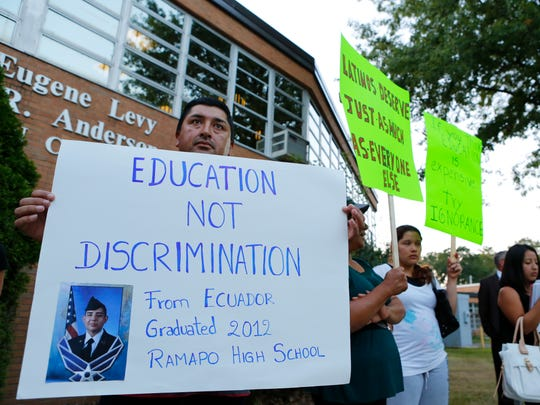 Jaime Calle of Spring Valley holds a sign praising
