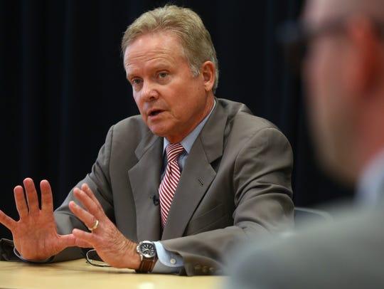 Former U.S. Sen. Jim Webb of Virginia talks to the