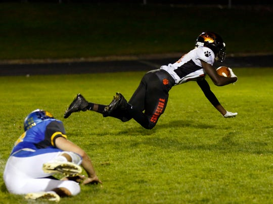 Stratford player Teddy Redman catches a pass and lands in the end zone during a playoff football game between Stratford High School and Bonduel High School in Bonduel, Wis., on Friday, October 20, 2017.