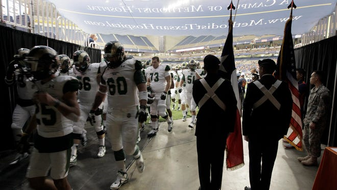 Sep 26, 2015; San Antonio, TX, USA; Members of the color guard prepare to bring the Texas and American flags onto the field before the game between Colorado State Rams and the University of Texas-San Antonio Roadrunners at the Alamodome. Mandatory Credit: Erich Schlegel-USA TODAY Sports