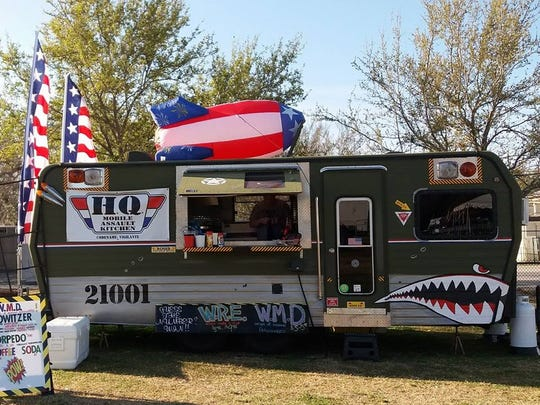 """The HQ Vigilante food truck is owned by Stephen and Melanie Pratt of Owosso. The truck specializes in what they call """"southern fusion"""" and will visit the City Market several times this summer."""