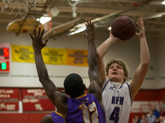 Rumson's Ian O'Connor goes up with shot against Camden's Deaquan Williams during first half action.  Camden Boys Basketball vs Rumson-Fair Haven in NJSIAA Group II Semifinal game in Perth Amboy, NJ on March 9, 2017