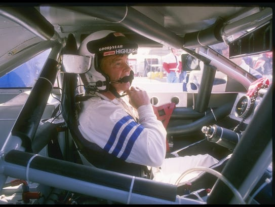 Dick Trickle sits in his car before the start of a