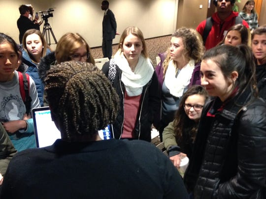 Ball State students huddle after a forum on Friday on President Trump's order banning citizens of seven countries from entering the U.S.