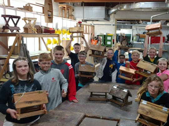 Leadership shown by upper classmen in the Ag-Tech classes is helping to lay the strong foundation for younger students as well building enthusiasm for the program. Here Junior High Ag-Tech: students sample a variety of disciplines in the course including building bird feeders in woodworking.