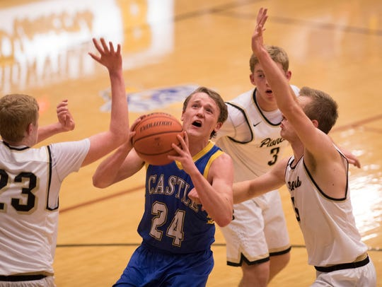 Castle's Jace Stieler (24) shoots for two over the