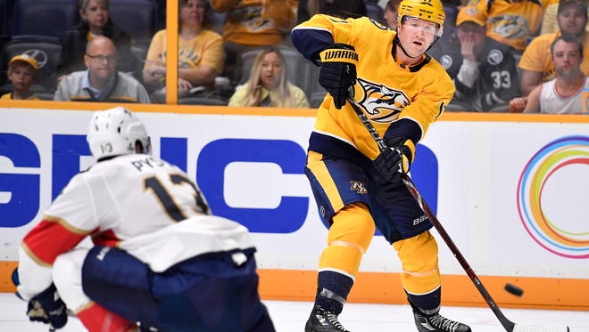 Predators forward Scott Hartnell (17) passes past Florida Panthers defenseman Mark Pysyk (13) during the second period in the second game of a preseason doubleheader Tuesday at Bridgestone Arena.