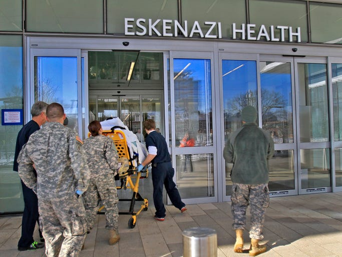 A patient is wheeled into the new Eskenazi Health, Saturday, December 7, 2013.  Patients were moved one by one from Wishard to the new Sidney & Lois Eskenazi Health Hospital today.