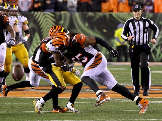 Cincinnati Bengals outside linebacker Vontaze Burfict (55) hits Pittsburgh Steelers wide receiver Antonio Brown (84) during the last 22 seconds of the game. Brown fell backwards after leaping for a throw from Steelers quarterback Ben Roethlisberger throw Saturday January 9, 2016. Paul Brown Stadium.