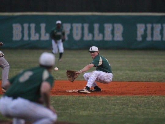 Lincoln's Connor Burk fields a pick-off attempt from catcher Dallen Leach.