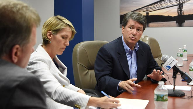 Congressional candidate John Faso, right, speaks with Opinion and Engagement Editor John Penney, left.