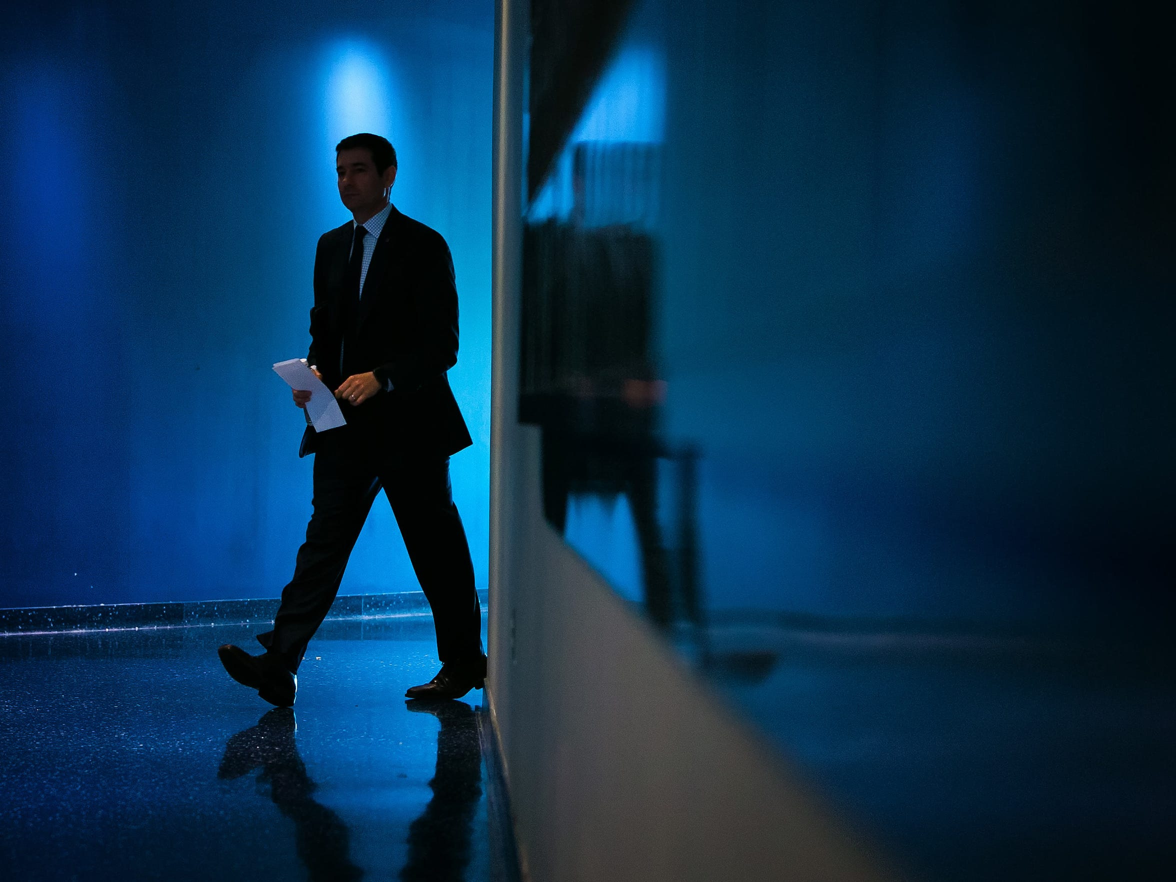 Martin Ingelsby walks the hallway of the Bob Carpenter Center on his way to the fan ceremony after he was announced as the University of Delaware's new basketball coach.