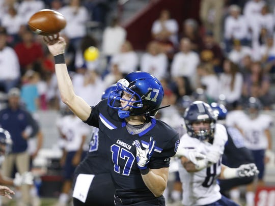 Chandler's Jacob Conover (17) passes the ball during