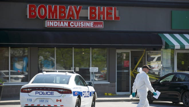 Police forensic officers work around the scene of an explosion at a restaurant in Mississauga, Ontario, on Friday, May 25, 2018.