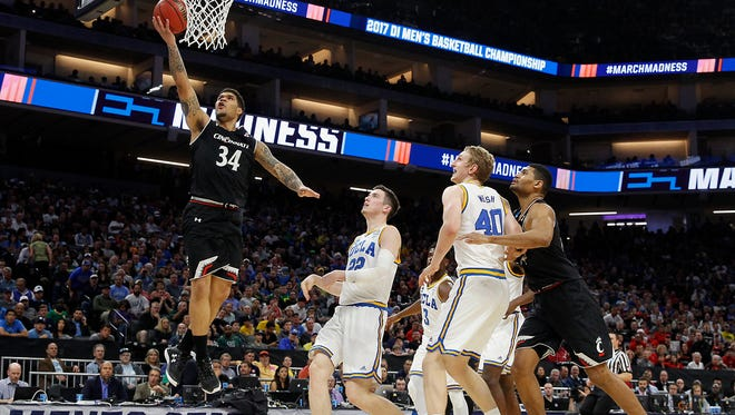 Cincinnati Bearcats guard Jarron Cumberland (34) scores on a layup in the second half during the second-round game of the men's NCAA college basketball tournament between the Cincinnati Bearcats and the UCLA Bruins, Sunday, March 19, 2017, at the Golden 1 Center in Sacramento, California. UCLA won 79-67.