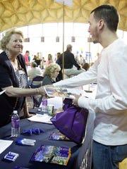 Elmira resident Matt Glynn shakes the hand of Guthrie