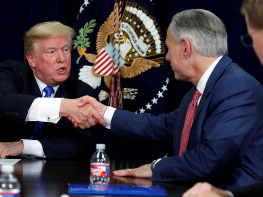 President Donald Trump shakes hands with Texas Gov.