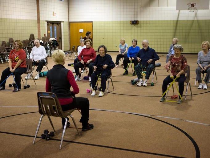 A senior exercise class held at Calvin Presbyterian Church celebrated Betty Ann Broecker's 100th birthday Friday. Broecker attends the class three times-a-week. Dec. 6, 2013
