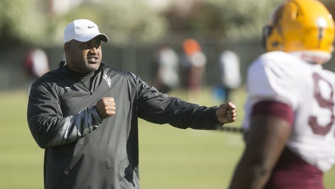 ASU defensive line coach Jackie Shipp coaches during an ASU Spring football practice in Tempe on Tuesday, April 7, 2015.