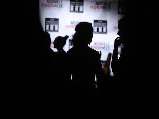 Patrons gather for drinks between shows on opening night of the fourth annual Nashville Fashion Week on Tuesday at Rosewall in Nashville.