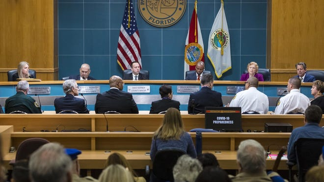 County commissioners listen to various county leaders talk about coronavirus preparations during the Palm Beach County Commission meeting on March 10.