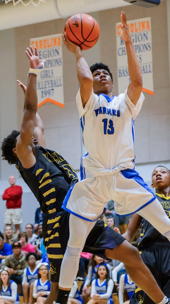 Greenville Tech's Jayden Brooks (13) shoots a layup against Keenan on Tuesday night during the third round of the Class AA boys basketball playoffs.