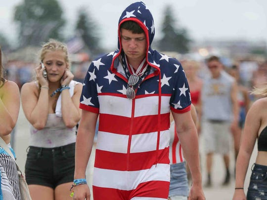 Max Polik walks slowly in his stars-and-striped romper during the 101st running of the Indy 500 at Indianapolis Motor Speedway on Sunday May 28, 2017.