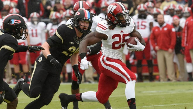 Nov 8, 2014; West Lafayette, IN, USA; Wisconsin Badgers running back Melvin Gordon (25) runs past Purdue Boilermakers linebacker Jimmy Herman (29) for a touchdown in the first half at Ross Ade Stadium. Mandatory Credit: Sandra Dukes-USA TODAY Sports