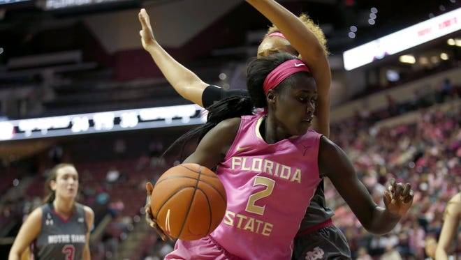 FSU's Adut Bulgak tries to get past Notre Dame's Brianna Turner during their matchup at the Tucker Civic Center on Monday.