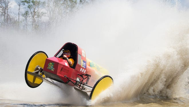 Pro-Modified racer Bobby Williams swamp buggy right side goes airborne on a sharp turn during the season finale at Florida Sports Park Sunday, April 8, 2018 in Naples.