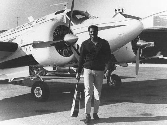 Otis Redding in front of his airplane.
