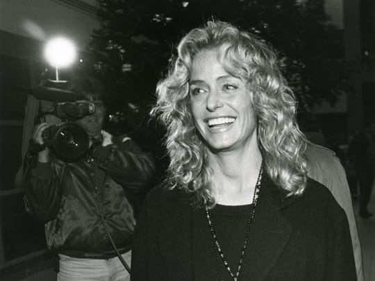 Farrah Fawcett, appearing at the Bay Area Medical Center on behalf of the Women's Shelter of the Corpus Christi Area in December 1993.