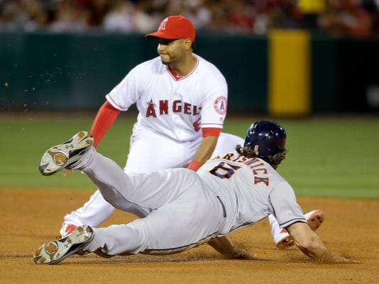 Houston Astros' Jake Marisnick steals second base past Los Angeles Angels shortstop Gregorio Petit during the fifth inning of a baseball game in Anaheim, Calif., Saturday, May 28, 2016. (AP Photo/Chris Carlson)
