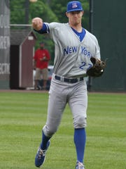 Rockland Boulders' Charlie Law works out in the outfield before their exhibition game against the NYPD baseball team, May 16, 2015.