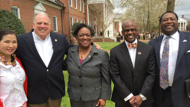 This April 21, 2016 photo shows  Maryland Gov. Larry Hogan and his wife, Yumi (far left), UMES President Juliette Bell (center), Rondall Allen, dean of the  UMES School of Pharmacy & Health Professions and another campus official in front of Somerset Hall at the University of Maryland Eastern Shore. Hogan has approved $3.5 million toward a proposed classroom building for the UMES School of Pharmacy and Health Professions. He and his wife visited UMES to celebrate the allocation.