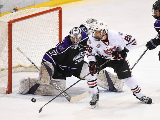 Minnesota State Mankato goalie Connor LaCouvee blocks