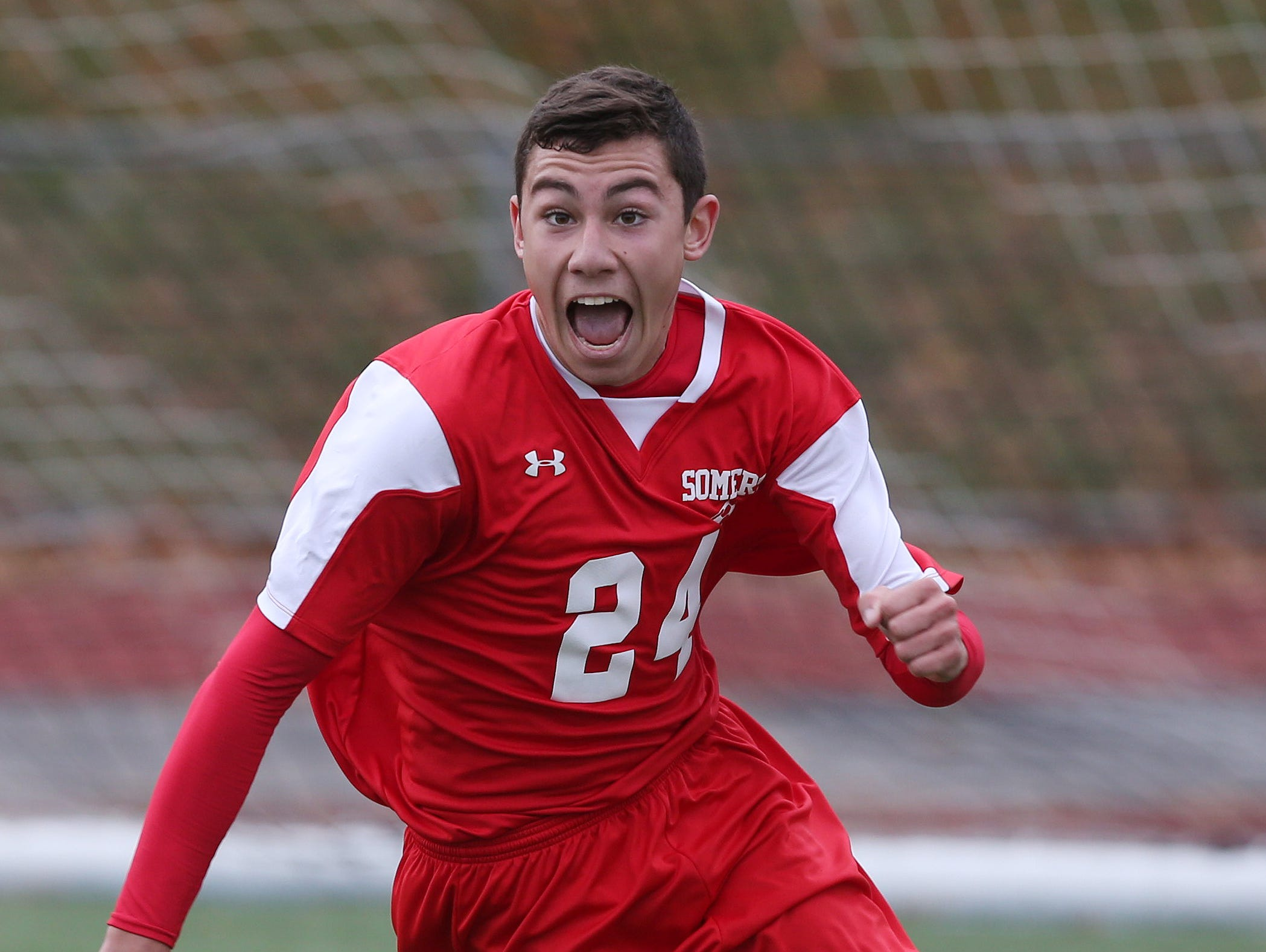 Somers' Andrew Lasher (24) celebrates his game winning goal against Pearl River in the boys soccer Section 1 Class A championship game at Lakeland High School in Shrub Oak High School Oct. 29, 2016. Somers won the game 1-0.