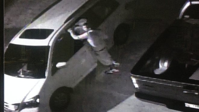 A homeowner's outdoor video surveillance camera caught a burglar attempting to break into vehicles in Bonita Springs.