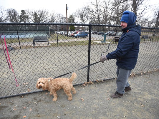 Teaneck resident Gilbert Bob with his dog, Wilmore, at Phelps Park in Teaneck on March 20, 2018. No dogs are allowed at Teaneck parks, with the exception of Phelps, which has a dog run.