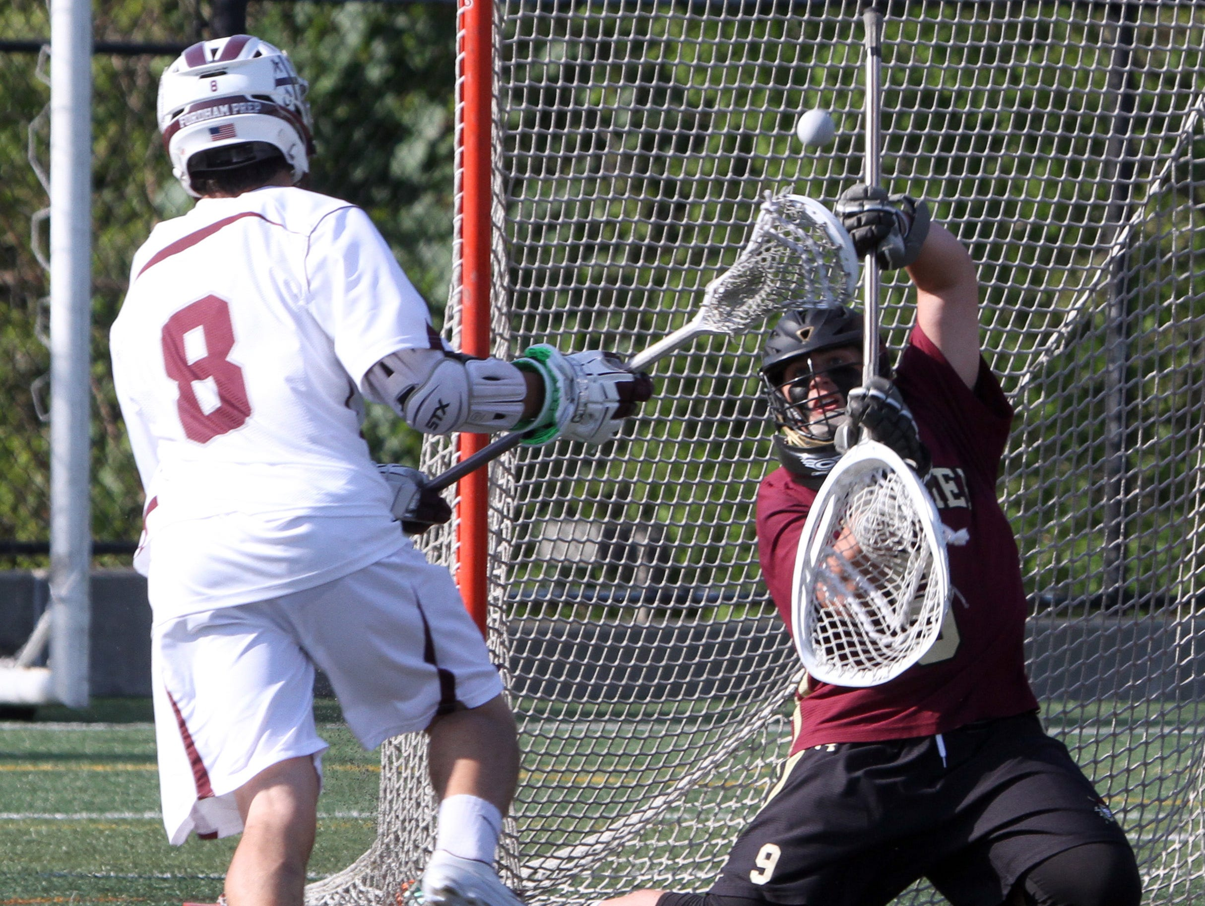 Iona Prep goalie Charlie McAllister deflects a shot by Fordham Prep's Andrew Abbattista during the CHSAA AA City Championship lacrosse game at Fordham Prep May 12, 2016. Iona Prep came from behind to defeat Fordham Prep 7-6.