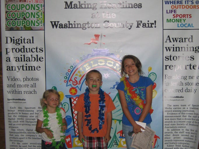 Visitors to the Washington County Fair stopped by The Spectrum booth to have their photo by our giant front page. Fun is definitely front-page news this year at the fair.